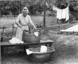 Woman with Wringer Washtub and Basket