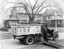 International Model S-26 Truck Delivering Coal to Residential Home