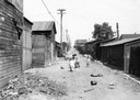 Young Children Play in Squalid Alley