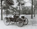 Man drives 1909 International Auto Wagon