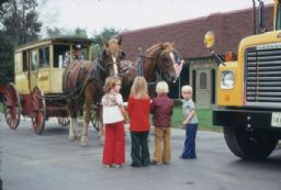 Horse-Drawn Carriage with Children and School Bus