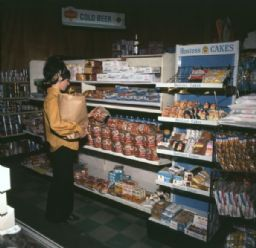 Woman in Store Aisle Examining Bread