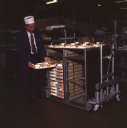 Man with Tray of Airline Food