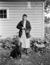 Ruth L. Brissee with Rifle and Dog
