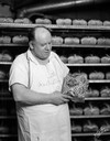 Baker Holding Loaf of Gardner's Bread