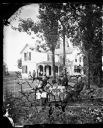 Family in front of Shuttered House