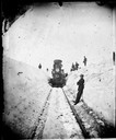 Men on Snow Bank with Madison-Portage Locomotive