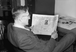 Phil Wackman Reading Newspaper