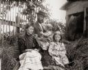 Dr. Edward A. Bass Family on Pile of Hay