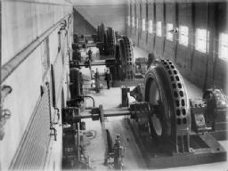 Man Standing by Generators in Power House
