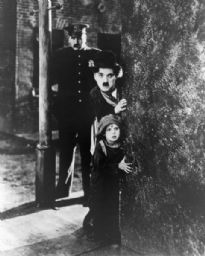Charlie Chaplin and Jackie Coogan in <i>The Kid.</i>