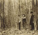 Dankoler and Two Men in Wooded Area