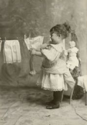 Margery Bish Hanging Clothes on Clothesline
