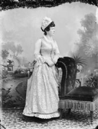 Studio Portrait of Woman and Chair