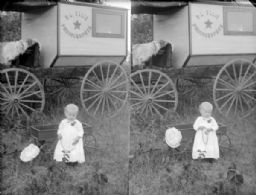 Small Child with Photographer's Wagon