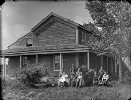 Group in the Yard Outside a Frame House