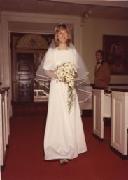 Bride Ruth Ann Berkholtz Walking Down the Aisle