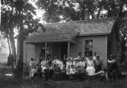 Family Posed in front of Farmhouse