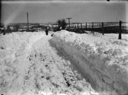 Shoveling Snow on Rural Road