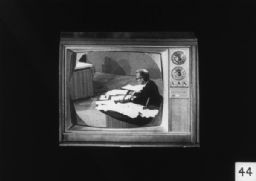 Man at Desk on Television