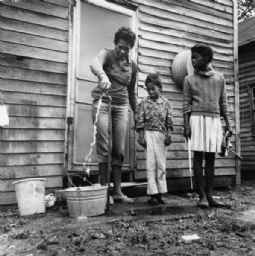 Woman and Children at Water Hydrant, Phelan's Quarters