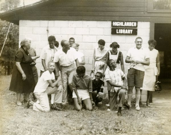 A photograph of Septima Clark (far left) with a group of studentsoutside of Highlander's library, undated, Highlander Research and Education Center Records, WHS