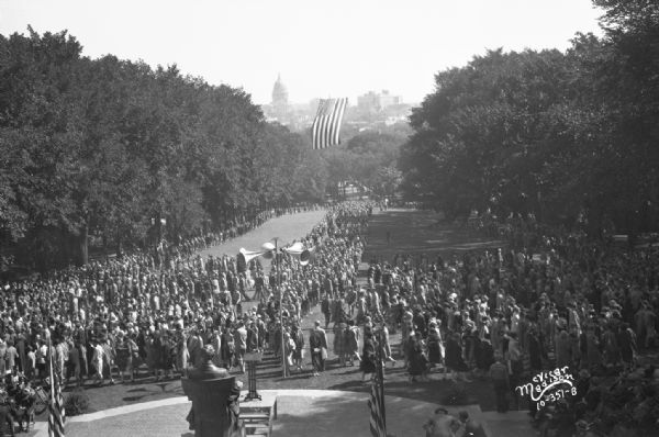 Elevated view of University of Wisconsin students on Bascom Hill, with the Wisconsin State Capitol in the distance.