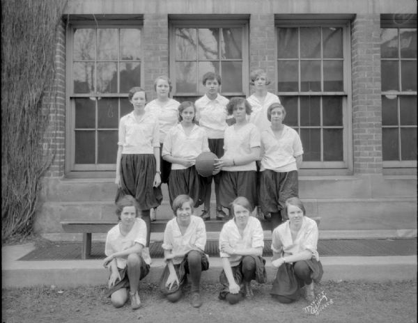 Outdoor group portrait of the Central High School 10B girls' basketball team.