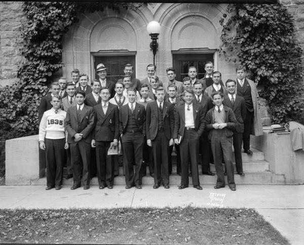 Group portrait of University of Wisconsin Botkin House male students in front of Tripp Hall.