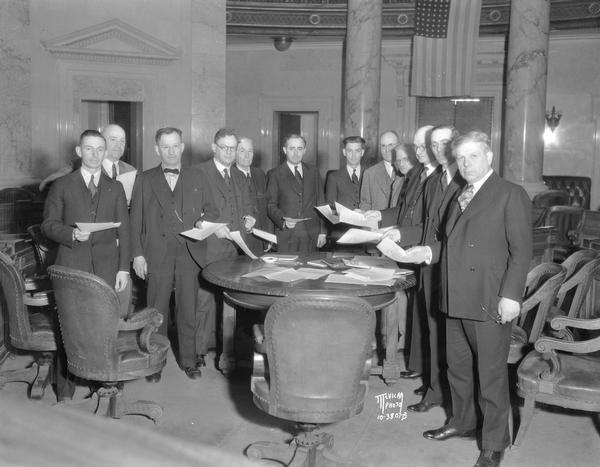 Wisconsin's twelve Democratic presidential electors in the Senate chamber after casting their unanimous vote to Franklin D. Roosevelt for president and John N. Garner for vice-president.