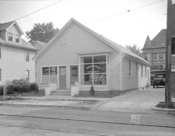 Volunteers of America Service Office and Service Shop, 414 S. Baldwin Street. Also shows the old Marquette School in the background.