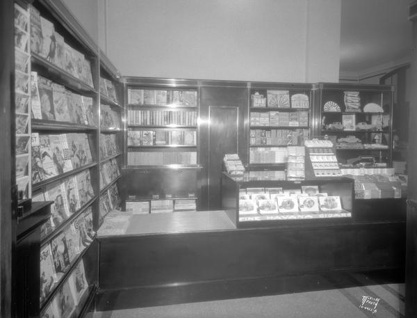 Interior of the Union Newsstand at the Chicago and North Western railroad depot, 219 S. Blair Street, showing cigars and magazines.