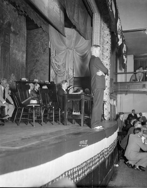 William T. Evjue, editor of The Capital Times, presiding over the Progressive convention, at which the delegates launched a new political party, the Progressive Party. Philip La Follette and several others are sitting on the stage.