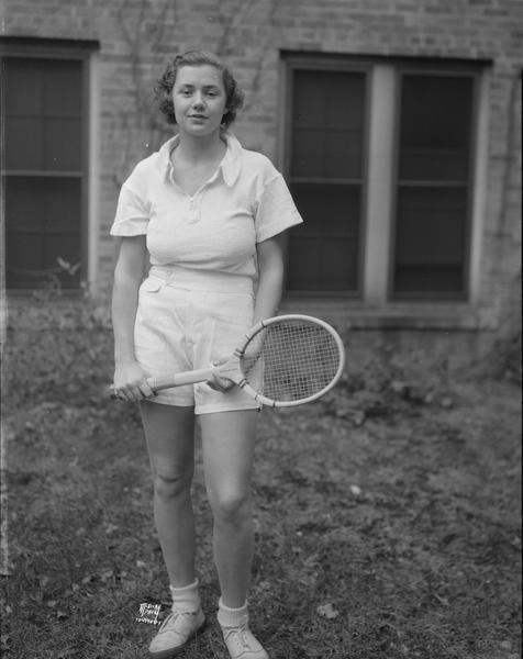 University of Wisconsin coed, Cecil McLaren, from Cincinnati, Ohio, holding tennis racket, co-champion in Western girls' doubles and finalist in National girls' tournament.
