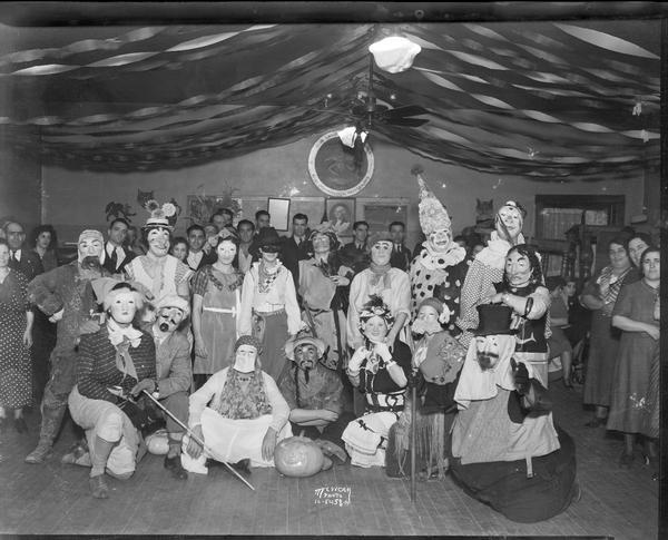 Group of people posing in Halloween costumes at the Italian Workingmen's Club at 914 Regent Street in the Greenbush neighborhood.