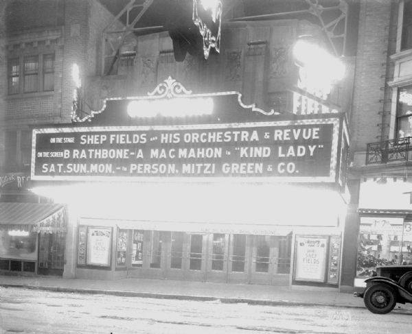 "Orpheum Theatre marquee lit up at night that says: ""On the stage Shep Fields and his orchestra & revue, on the screen B. Rathbone - A. MacMahon in 'Kind Lady,' in person Mitzi Green & Co."""