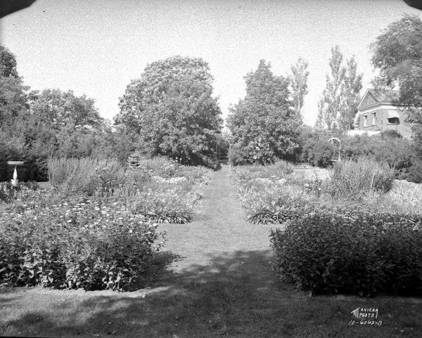 Dr. Frederick A. and Edith Davis's flower garden, 6048 S. Highlands Avenue, called Edenfred, from the east end.