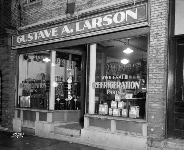 Gustave A. Larson storefront, 205 E. Main Street. Wholesale refrigeration parts and Texeco Capella Oil.