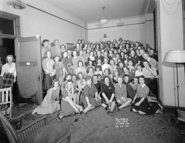 Group portrait of telephone operators at a party.