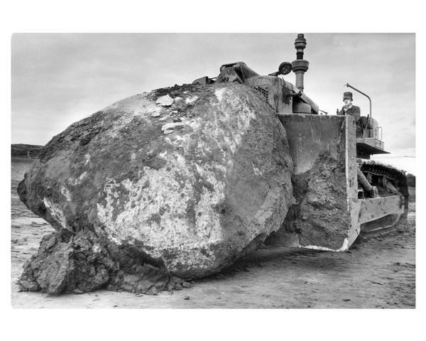 Moving a very large boulder with a bulldozer during construction of  Highway 94 in Waukesha County.