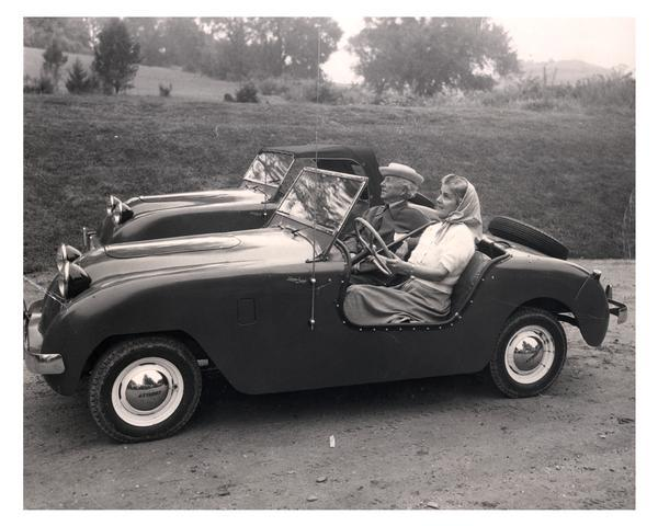 Frank Lloyd Wright and Olgivanna Lloyd Wright, motoring in the country in a Crosley car. Another car is behind them.