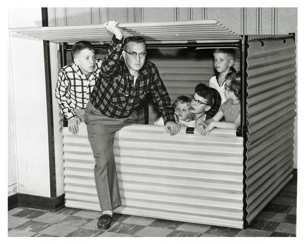 A Wisconsin family inside their new bomb shelter.