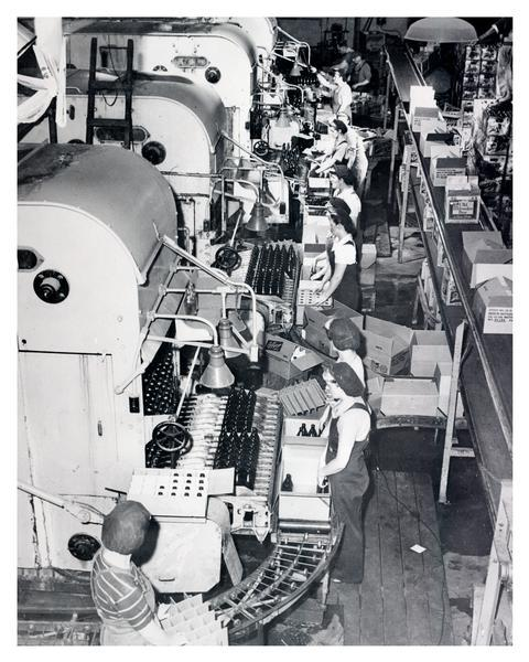 Workers on the bottling line at the Schlitz Brewery.