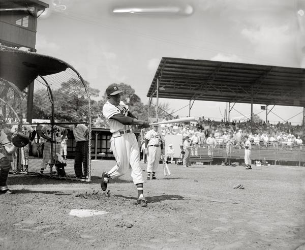"Henry ""Hank"" Aaron at bat during a Milwaukee Braves pre-season game."