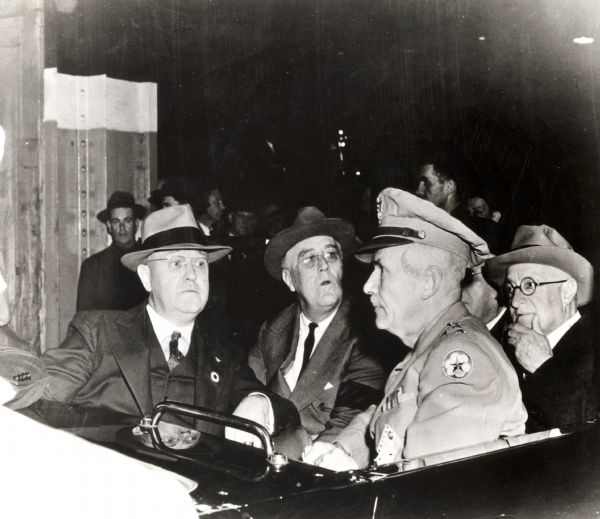 Franklin D. Roosevelt, Wisconsin Governor Julius P. Heil, and other officials touring the Allis-Chalmers plant.