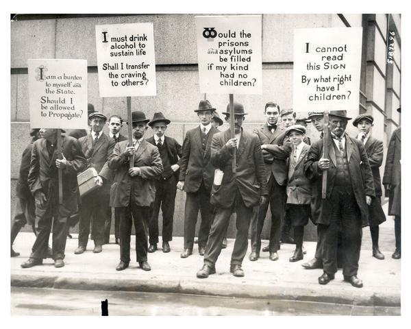 "Four impoverished men hired by ""The Medical Review of Reviews"" carry signs with the eugenics slogans, ""I am a burden to myself and the State. Should I be allowed to propagate?,"" ""I must drink alcohol to sustain life. Shall I transfer the craving to others?,"" ""Would prisons and asylums be filled if my kind had no children?,"" and ""I cannot read this Sign. By what right have I children?""  This demonstration was one of a series of events organized by Frederic Robinson and Edward Bernays of The Medical Review of Reviews' Sociological Fund Committee including the eugenics play ""Damaged Goods,"" the motion pictures ""The Inside of the White Slave Trade"" and ""The Drug Terror,"" and meetings such as the ""Symposium on Euthanasia"" and ""Symposium on the Sterilization of the Unfit."""