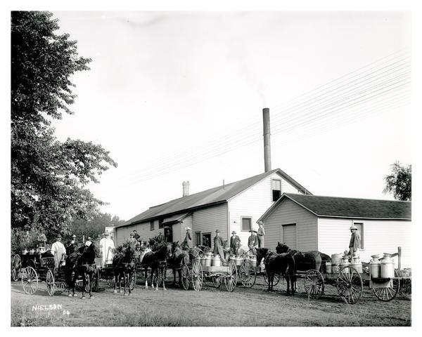 Farmers delivering their milk in wagons to a dairy plant on Black Creek Road near Appleton.  The advent of automobiles would vastly improve farmers ability to take their goods to market.