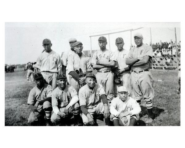 Indian school (U.S. Indian Service) baseball team, posed in uniform during a baseball game.