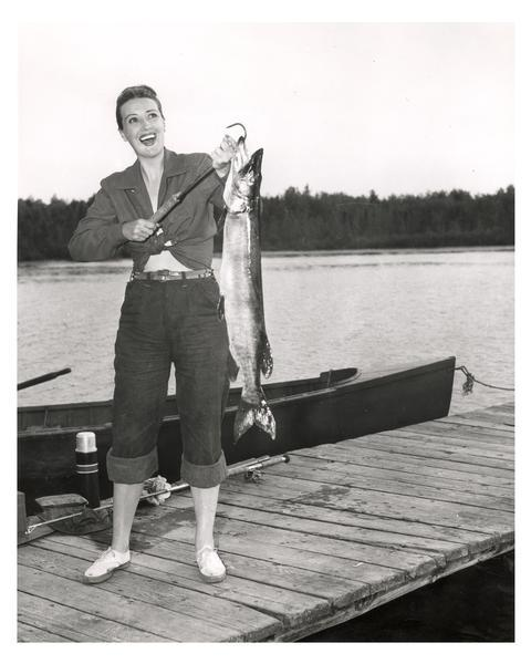 Gypsy Rose Lee (aka Louise Hovick, 1914-1970) with a large muskie she caught in a northern Wisconsin lake.