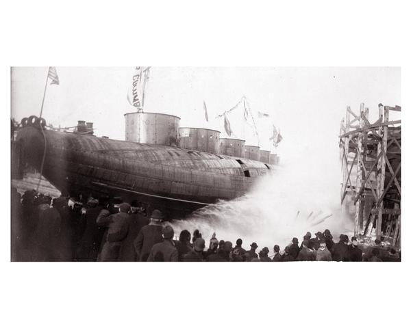 "Launching Captain Abe McDougall's whaleback boat, ""Christopher Columbus,"" from the American Steel Barge Company dock."